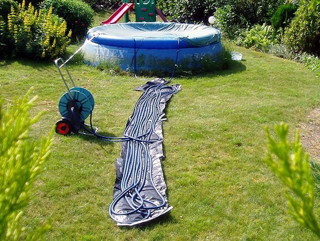 Verwarming van een zwembad door zonnewarmte for Zwembad rechthoekig met pomp